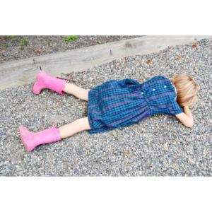 girl laying on ground